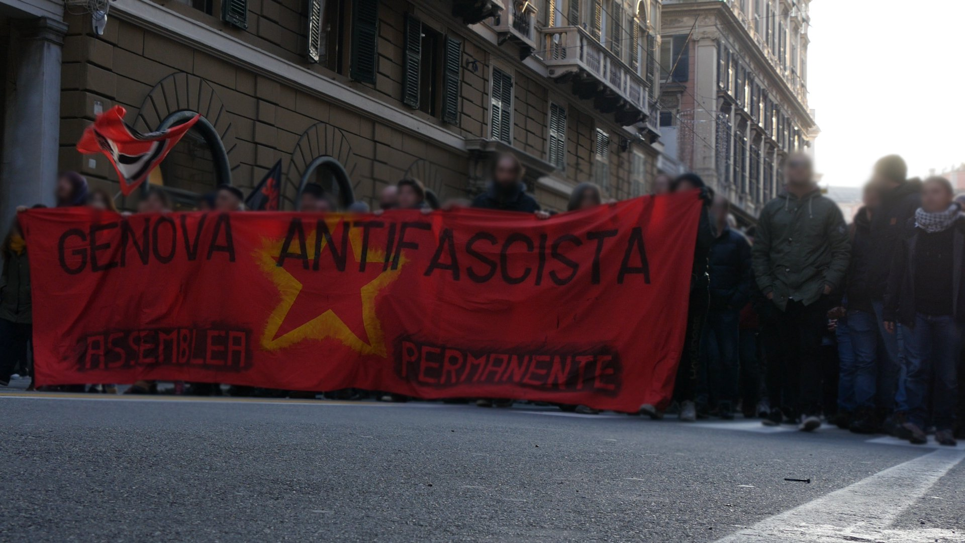 Banner in der Demonstration in Genua